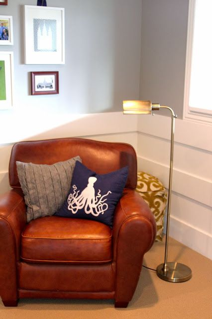 3 horizontal planks- modern looking chair rail. Also love the wall color and that great club chair