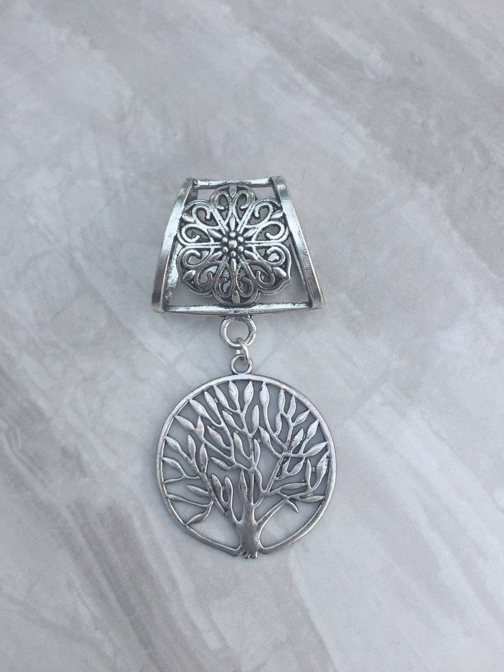A personal favourite from my Etsy shop https://www.etsy.com/uk/listing/488707897/silver-tree-of-life-scarf-bail-silver