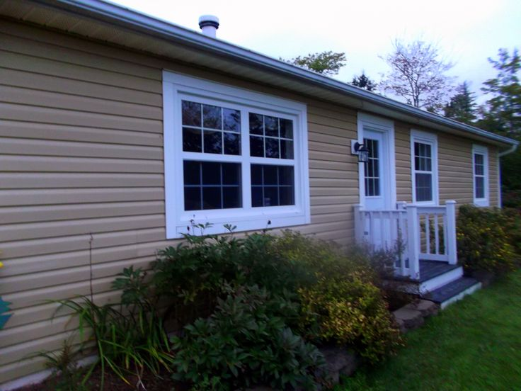 Renovation Using : Kaycan Vinyl Siding & Allweather Windows and Doors. Available at HubCraft Timber Mart.
