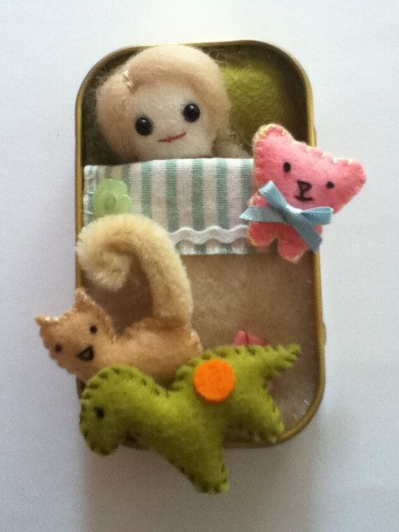 Doll in a tin with kitten dinosaur and teddy by nicolaluke