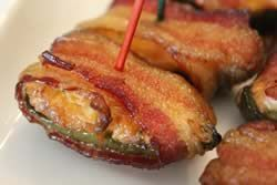 Jalapeño peppers stuffed with cream cheese filling, wrapped in bacon and smoked for 3 hours.. OMG!
