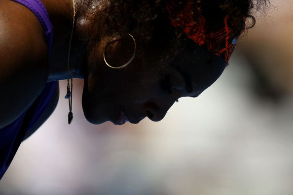 Serena Williams Serena Williams of the United States looks on in her first round match against Edina Gallovits-Hall of Romania during day tw...