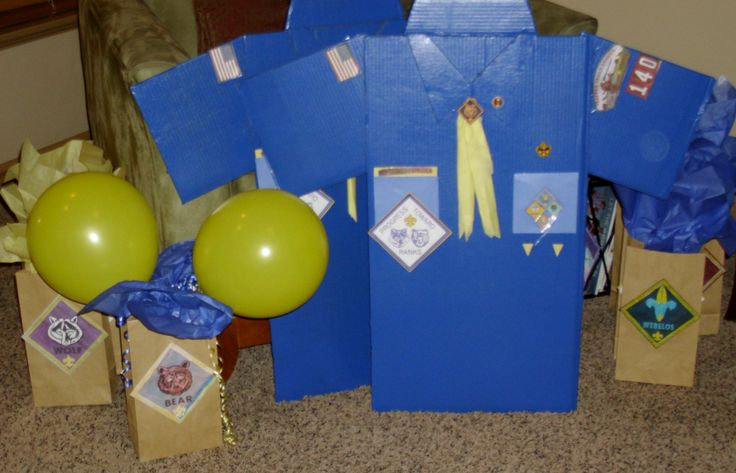 CubScout blue and gold banquet.  Made shirts from wardrobe moving boxes and the rustoleum with primer covered in 2 coats.  The badges have been copied off onto the printer from my leader shirt and from the scout on line images.  The bags are decorated by the scout coloring on the images I blew up that are the insignias.