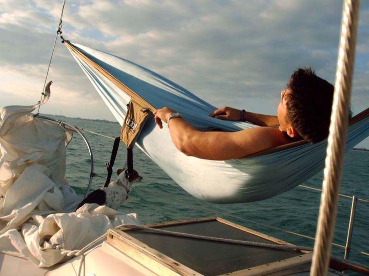 A hammock on a boat with a dog = <3 (photo via ENO)