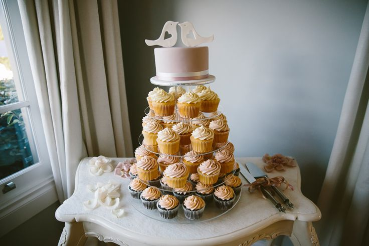 Cupcake tower wedding cake. Blush pink frosting and love bird cake topper. Image: Cavanagh Photography http://cavanaghphotography.com.au