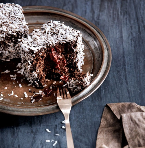 Triple-Chocolate Lamingtons ~ the traditional butter cake has been swapped for chocolate cake in these lamingtons, and the stakes raised with a chocolate cream and raspberry jam.