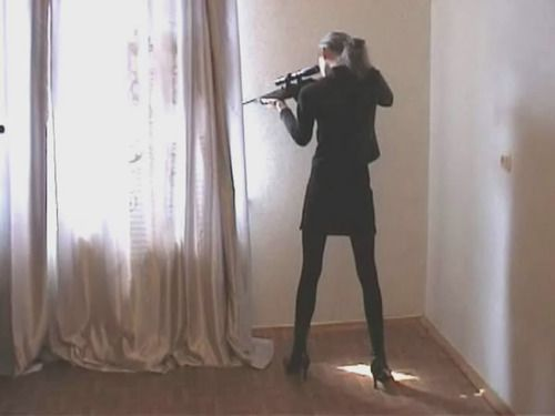 "This was not how she envisioned her day ending; wearing high heels, makeup done perfectly, ponytail pulled tightly back. ""This is ludicrous"" she mumbled to herself as she raised the rifle to cover her brother. ~ HJN"