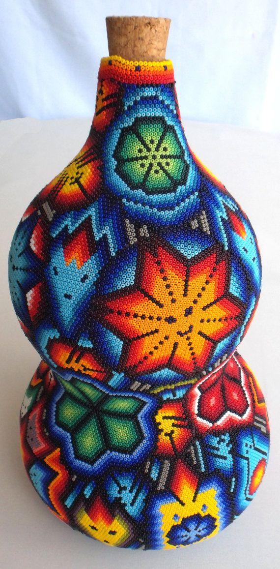 Mexican Huichol Beaded Sacred Gourd Bottle  Calabash by Aramara Admiro el arte hichol por el trabajo tan minucioso de poner una cuentita de chakira a la vez para formar dieños bellísimos.