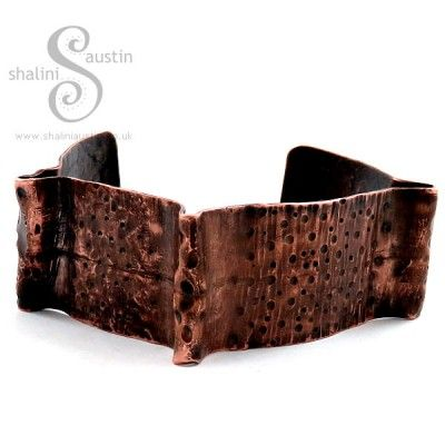 Copper cuff, cut individually from copper sheet and designed using a technique called fold forming which involves a lot of annealing and lots of hammering.Image on the right shows some more example of this style, as these are individually hand-crafted there is only one piece of each design available. The bracelets are listed individually in our shop.