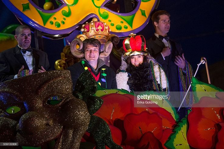 Actors Nathan Fillion and Krista Allen ride in the Krewe of Orpheus parade on February 8, 2016 in New Orleans, Louisiana.