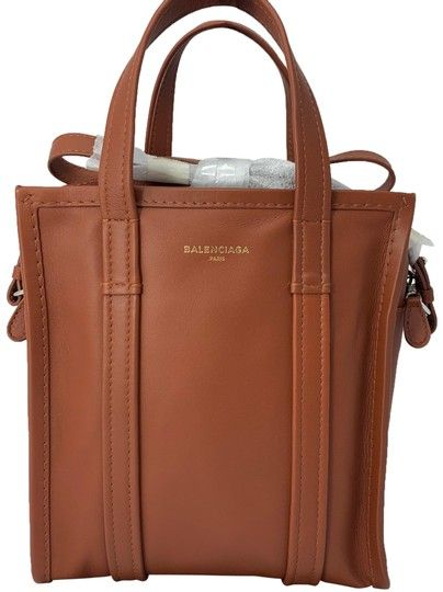 99339f77d28c Get one of the hottest styles of the season! The Balenciaga Bazar Shopper  X- Small Tan Leather Tote is a top 10 member favorite on Tradesy.