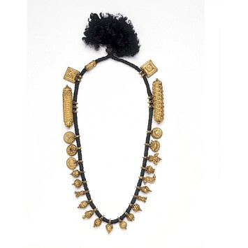 Marriage necklace, or thali, consisting of golden pendants on black thread.