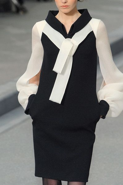 Chanel - not quite the little black dress; this beauty has cream sleeves ...
