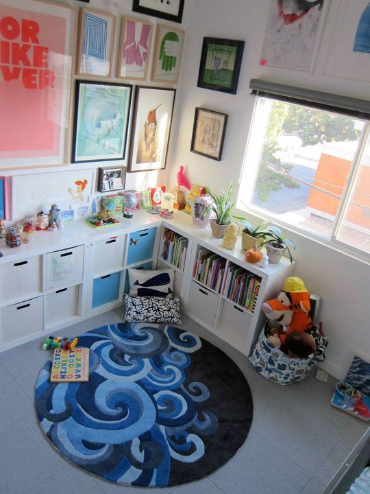 Ikea Expedit 2x2 and 2x4 shelves combined into a corner shelving unit. Perfect for kid-height storage.