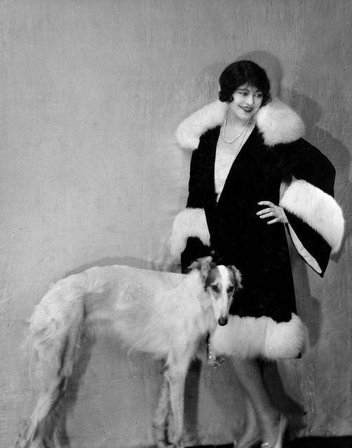 """""""Model wearing fashionable fur-trimmed coat with Russian Wolfhound dog at her side."""" #vintage #fashion #1920s #dog"""