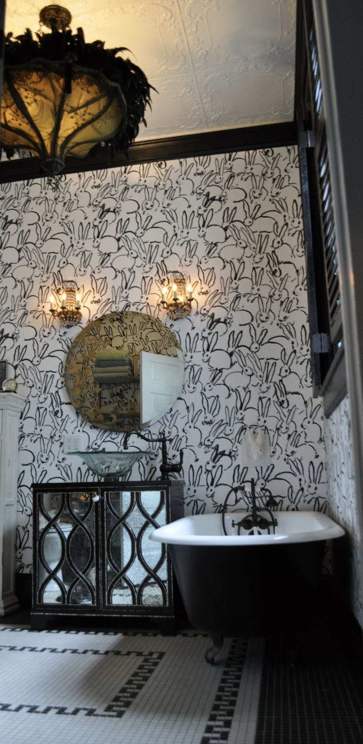 """A new Lee Jofa wallpaper, Hunt Slonem's """"Hopalong"""" creates a fun and playful bathroom in this historic old home."""