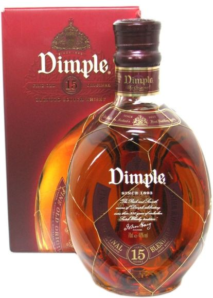 Dimple de Luxe Whisky 15 year-Old Scotch Blended Whisky.....Dimple is distinguished by its famous triangular bottle. First produced in 1888 by John Aloysius Haig.