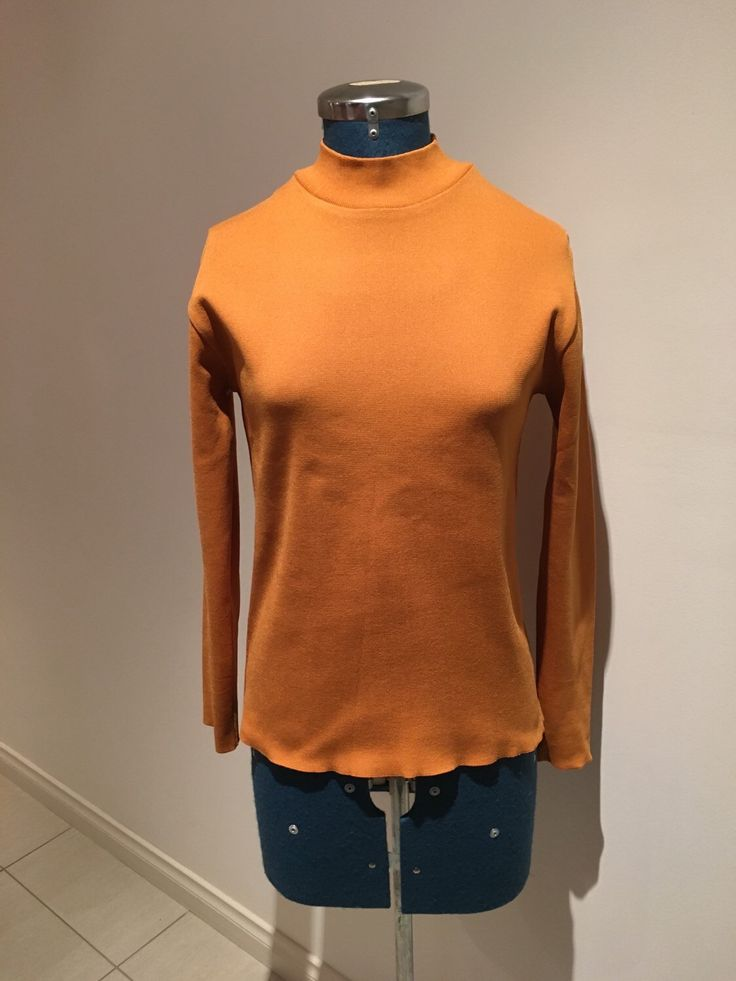 A personal favourite from my Etsy shop https://www.etsy.com/au/listing/270159378/vintage-1970s-mustard-stretch-turtleneck