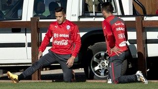 Chile's national football team players Alexis Sanchez (L) and Mauricio Isla stretch