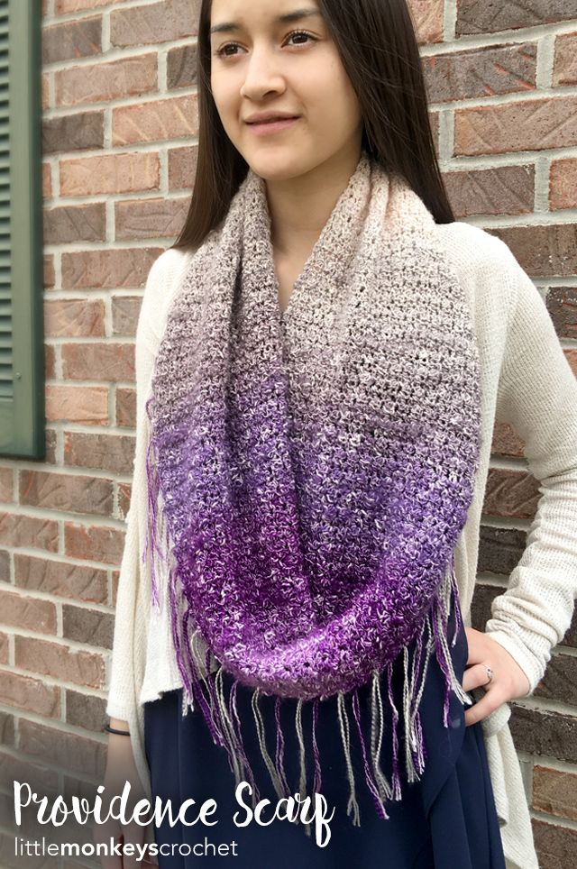 One skein of Lion Brand's new yarn, Shawl In A Ball, is all it takes to make this beautiful lightweight scarf! Providence Scarf Crochet Pattern | Free crochet fringe infinity scarf pattern by Little Monkeys Crochet