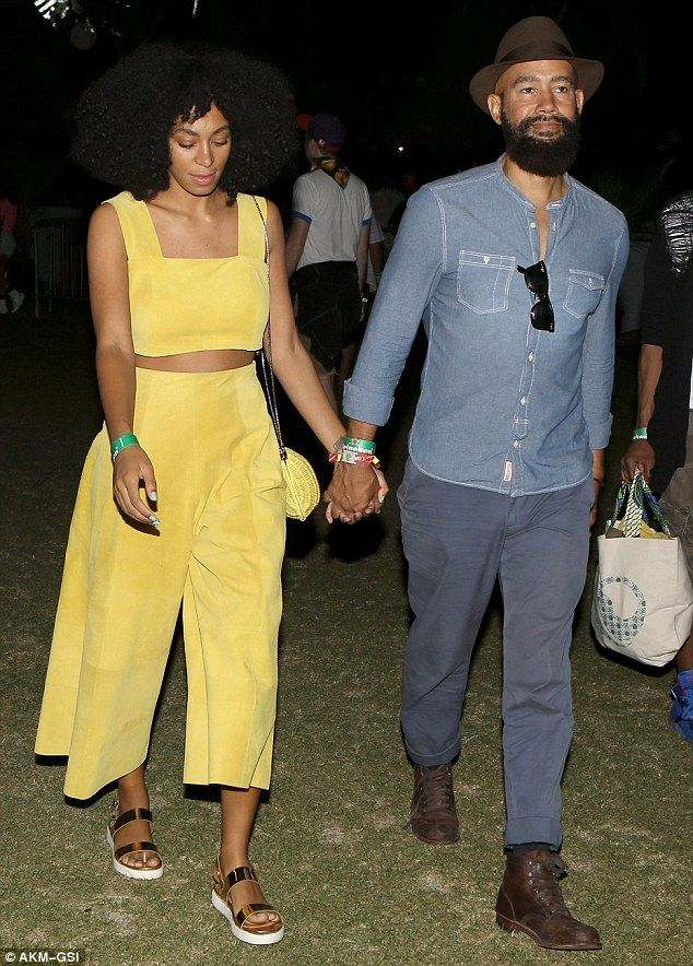 A desert stroll: Solange and her music video director boyfriend Alan Ferguson held hands as they made their way through Coachella Music Festival in the Californian desert on Friday night