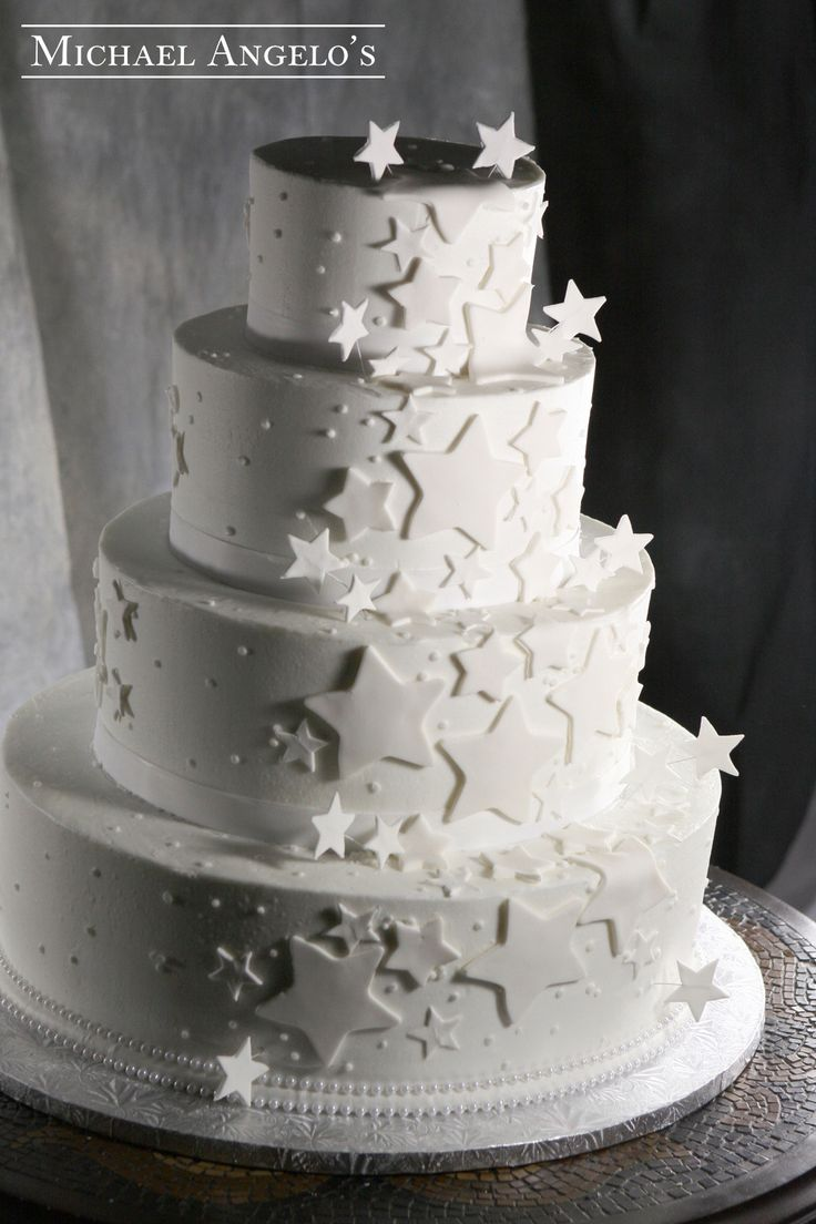 Starlight Wedding #39Specialty This cake is perfect for that starry wedding night. It is iced in buttercream and accented with fondant stars of all sizes. They are placed in clusters all around each layer with some free standing to give the cake depth.