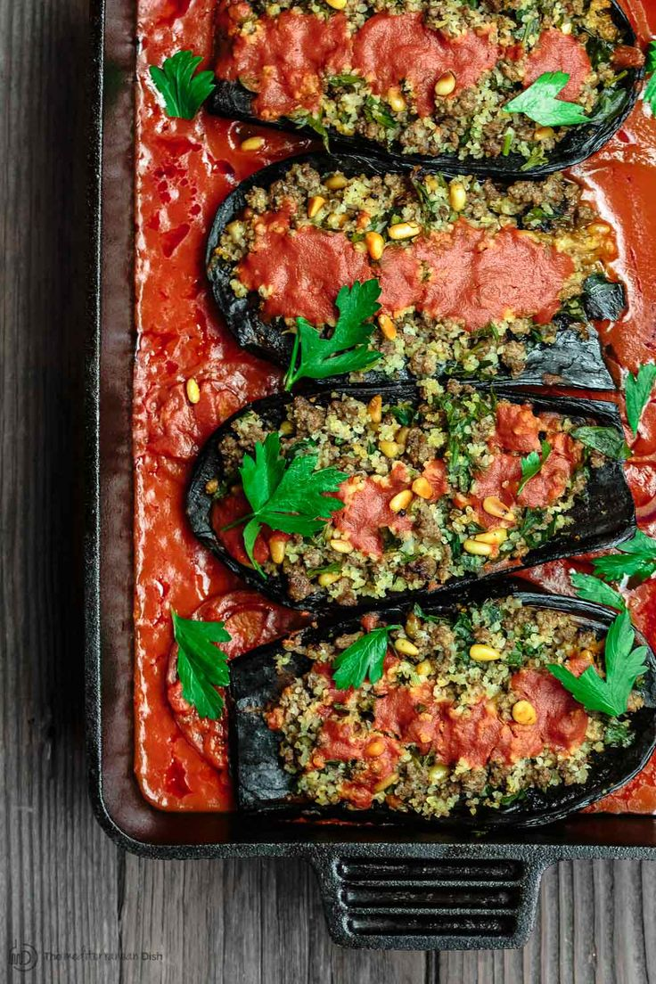 All-star stuffed eggplant recipe w/ a Middle Eastern twist! Roasted eggplant stuffed w/ a fragrant mixture of spiced meat, bulgur and pine nuts. Delicious!