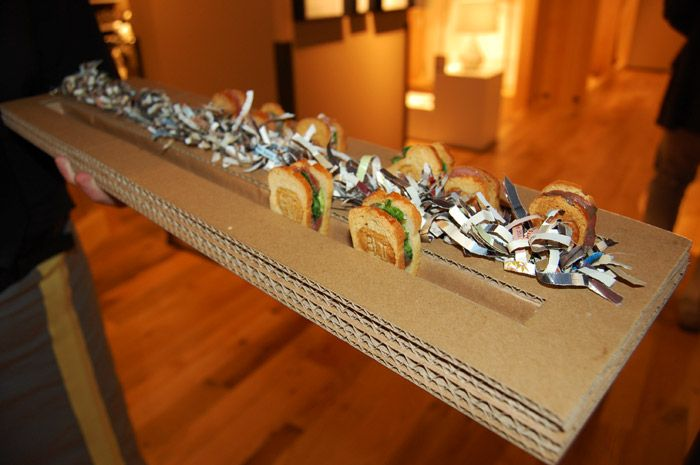 Catering trays used by Creative Edge were also made with old boxes and shredded pieces of West Elm's old catalogs.
