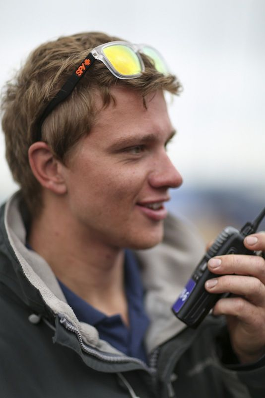 A picture from the National Youth Regatta featuring a two-way radio user.