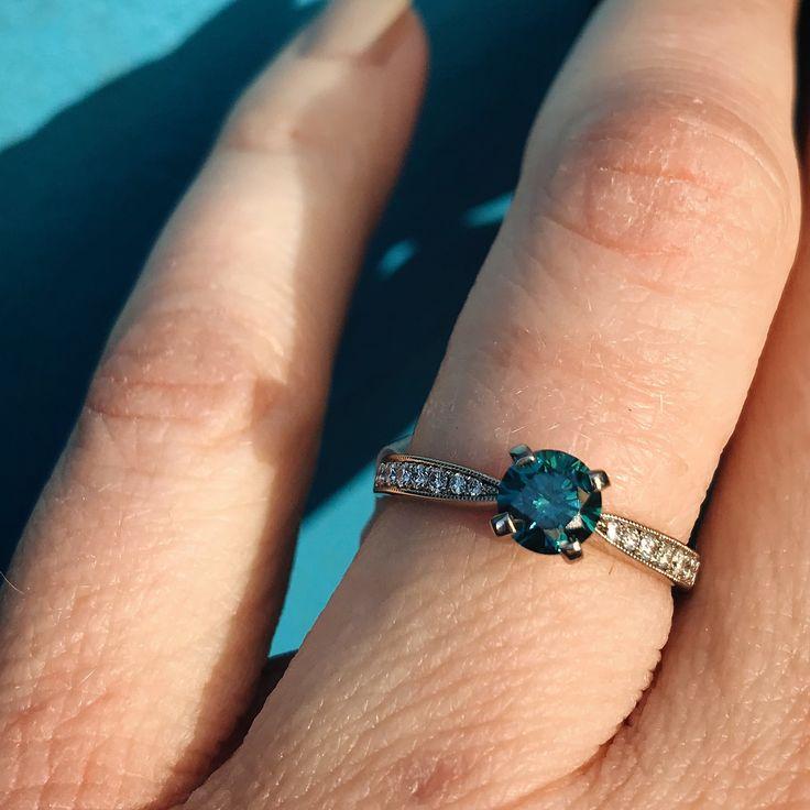 Blue diamond solitaire with diamond shoulders