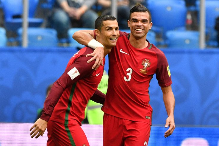 Portugal's forward Cristiano Ronaldo (L) celebrates with Portugal's defender Pepe after scoring a penalty during the 2017 Confederations Cup group A football match between New Zealand and Portugal at the Saint Petersburg Stadium in Saint Petersburg on June 24, 2017. / AFP PHOTO / Mladen ANTONOV