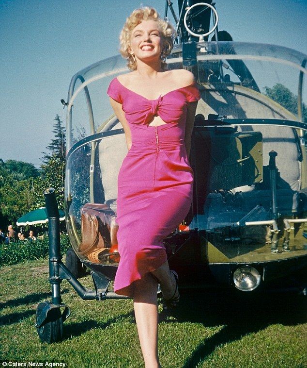 Marilyn Monroe poses next to a helicopter as she arrives at legendary crooner Ray Anthony's party