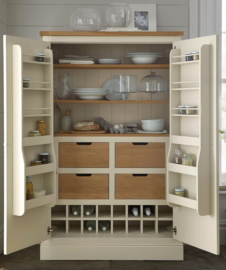 If you need more room for keeping food or crockery, a gorgeous larder unit is the ideal solution.