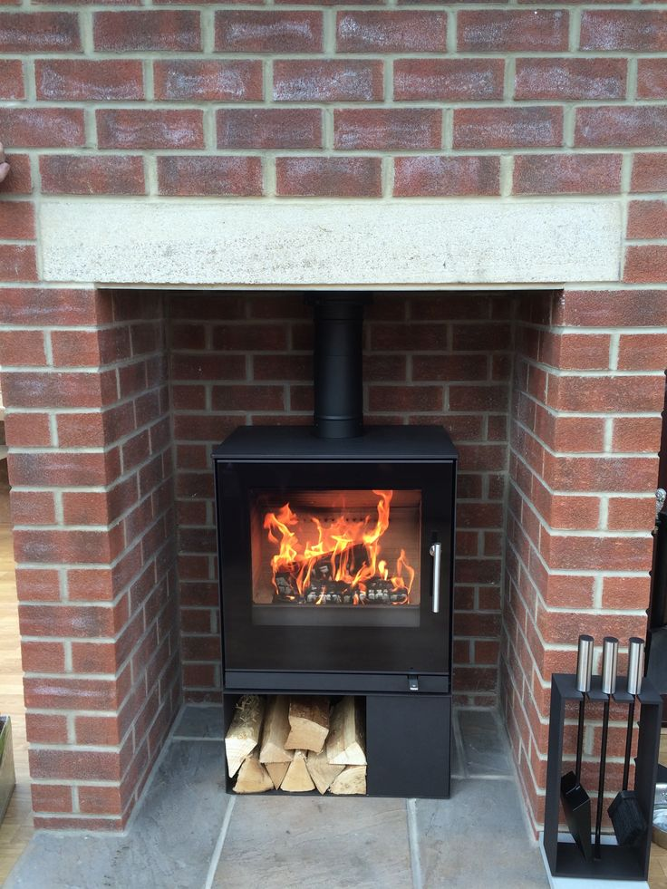 #Rais stove in an old #fireplace for a #modern look