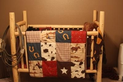 Rustic homemade baby crib that we made from pine logs: Our baby's American Western Nursery Theme has many pieces of rustic, homemade furniture and decorations that were all made by myself and my uncle.  SEE