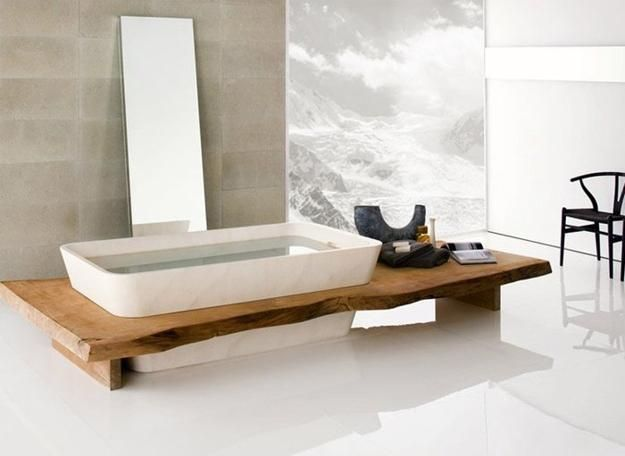 Wood covering for a bathroom tub is an elegant and beautiful decorating idea that brings warmth into bathroom design and helps create coziness