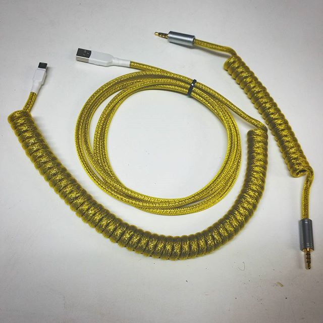 Tinned copper and yellow Techflex sleeving. Coiled ergodox keyboard cables. Pexon.