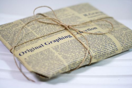 Iron newspapers to give them an aged look, then use as wrapping paper.  Would be very cool to use foreign language papers!