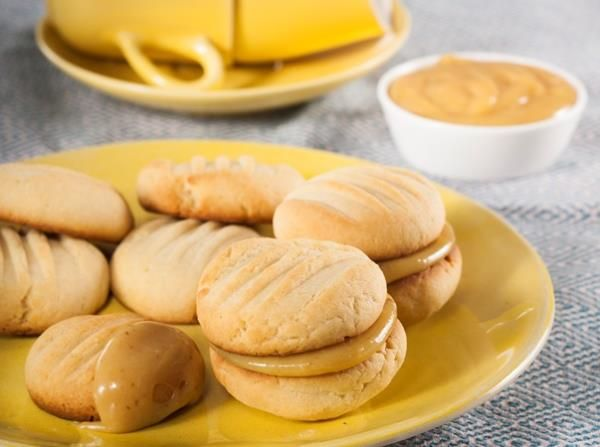 These condensed milk cookies sandwiched together with a caramel filling are so good you might not want to share!