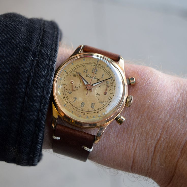 A 1950's Vintage Breitling Chronograph Ref. 351 that features a Rose Gold plated case with a stainless steel case back, a golden brown dial with Arabic numerals, and a manual caliber L48 movement. (Store Inventory # 9809, listed at $2800).