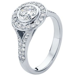 The 'Soleil' Engagement Ring with a diamond halo surrounding a 0.72ct round brilliant diamond