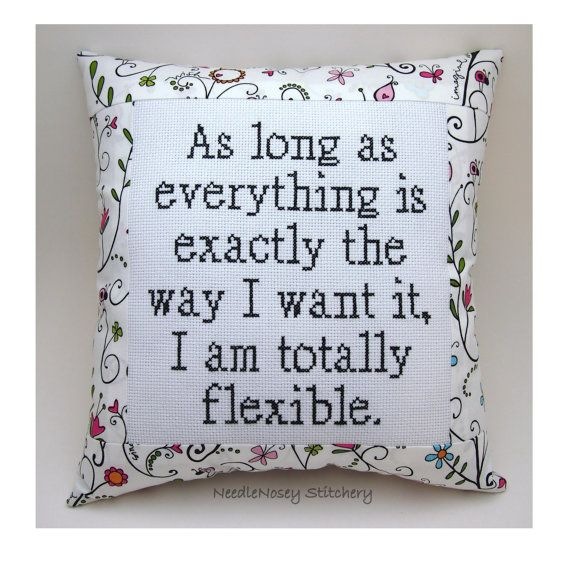 This is a funny cross stitch pillow done in black. It measures roughly 10 x 10 inches in size at the outside dimensions. The stitching is done on