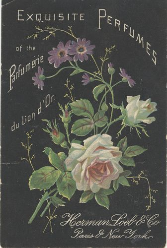 Beautiful vintage black & floral perfume ad