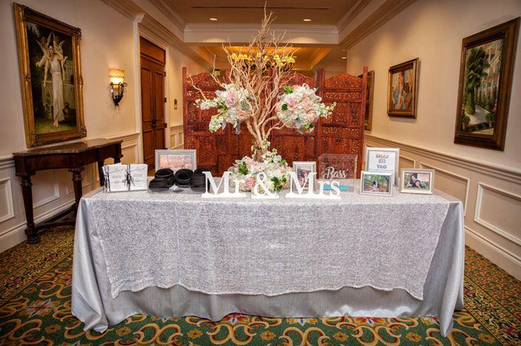 A beautiful wedding receiving table display (Jeff Kolodny Photography)