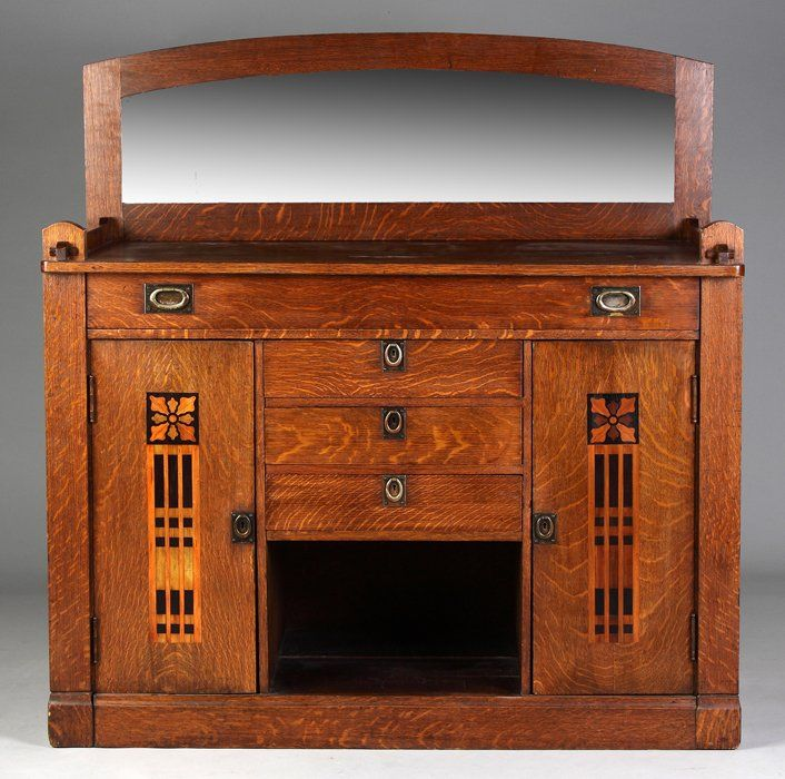 "Shop of the Crafters, Cincinnati, Sideboard. 1/4 sawn oak w/various wood inlays. Original label on reverse. Original hammered metal hardware. Ht. 38 1/2"" W 53 1/2"" D 25"" Max. Ht. 56"""