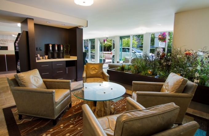 Relax with a cup of complimentary coffee and paper in our warm and inviting lobby.