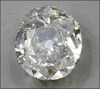 The Koh-i-Noor diamond is the largest stone in the crown worn by Queen Elizabeth The Queen Mother. 'Koh-i-Noor' means 'Mountain of light'. Great-Britain.
