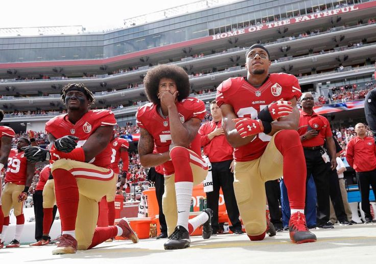 COWBOYS 24 - 49'ers -17:    San Francisco 49ers outside linebacker Eli Harold, left, quarterback Colin Kaepernick, center, and safety Eric Reid kneel during the national anthem before an NFL football game against the Dallas Cowboys in Santa Clara, Calif., Sunday, Oct. 2, 2016.