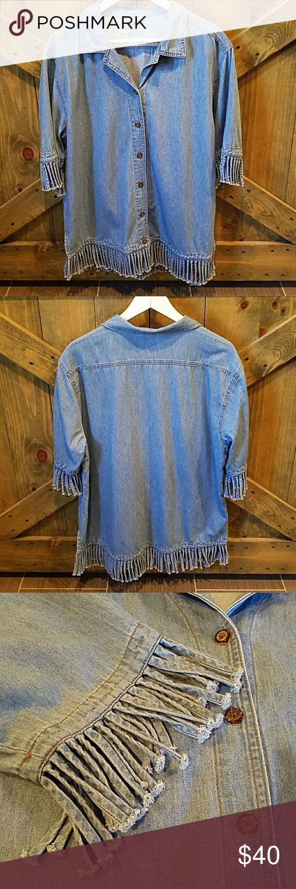 CMC Short Sleeve Fringed Denim Shirt Be different!, this denim shirt is so cool, has fringes around the sleeves and on the bottom hem, 6 buttons down the front all present, has slits on the side for ease and comfort, has collar at top no ring around the collar, by Color Me Cotton, size large, no rips or stains, great with brown boots and leggings Color Me Cotton Tops