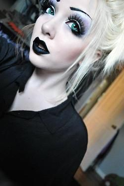 Gothic make up, snow white skin and blonde hair.
